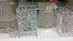 Purchase inexpensive fancy candle holders and insert plastic jars and make a unique flower centerpiece for your table or turn them upside down and hang them with a class jar candle.