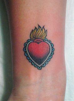 milagro heart tattoo