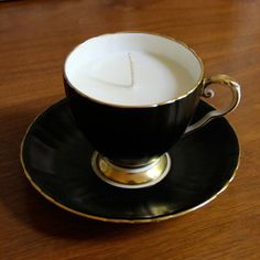 teacup candle...Centerpiece? If the teacup is thin, when the wax melts down the teacup glows!