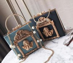 Luxury 3D Golden Angel Handbag! Victorian Vintage Elegant Glamour Fashion! Pearls, rhinestones, and Gold Hardware Make This Luxurious, and vegan leather makes it cruelty free and absolutely precious! So kawaii! 💖 100% FREE Shipping Worldwide! 💖Tons more Kawaii, Lolita, Harajuku, Fairy-Kei, Larme, Pastel-Goth, Cosplay, Magical Girl, and Harajuku Japan Fashion Goodies at www.KawaiiBabe.com 💖 Harajuku Fashion, Harajuku Japan, Japan Fashion, Kawaii Fashion, Fashion Bags, Fashion Outfits, Fendi, Gucci, Luxury Bags