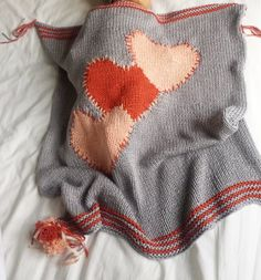 Baby D 3 heart blanket with pompom trims knitting project shared on the LoveKnitting community. Find this project and more inspiration at LoveKnitting.Com!
