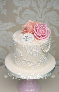 A replica of the top tier of one of my 2014 Bride's wedding cakes made to celebrate her 30th birthday. Sugar lace, sugar peach and pink roses with pearls and a personalised tag.