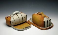 Delores Fortuna makes these wonderful big butter dishes, and I use one every day in my house.  They were thrown on the wheel and then cut and altered into the perfect butter dish shape.