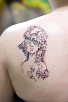 audrey kawasaki inspired back tattoo...the epitome of femininity, softness, and gentleness.