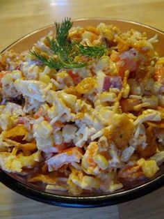 Paula Deen Frito and Corn Salad -- 2 (15 ounce) cans whole kernel corn, drained - 2 cups grated cheddar cheese - 1 cup mayonnaise - 1 cup green pepper, chopped - 1/2 cup red onion, chopped - 1 (10 1/2 ounce) bag coarsely crushed Fritos chili cheese corn chips (If unable to find, mix 1/2 regular and 1/2 barbeque corn chips) -- Directions: Mix first 5 ingredients and chill. Stir in corn chips just before serving.