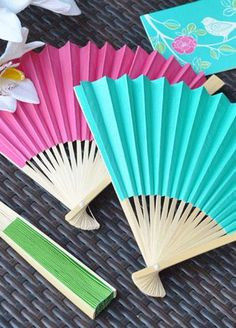 Wedding fan favors in a variety of colors and themes. Fan favors are great for a beach or summer wedding or shower. These wedding fans will help to keep your guests cool! Colourful Wedding Favours, Modern Wedding Favors, Summer Wedding Favors, Hand Fans For Wedding, Wedding Hands, Unique Wedding Favors, Wedding Colors, Summer Weddings, Wedding Ideas