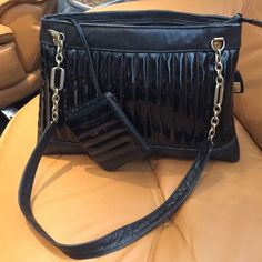 Black Anne Klein handbag Preloved but still in good condition. Comes with an attached wallet. Some of the Gold hardware has discolored but not noticeable. Very roomy and has a zipper pocket inside Anne Klein Bags Shoulder Bags