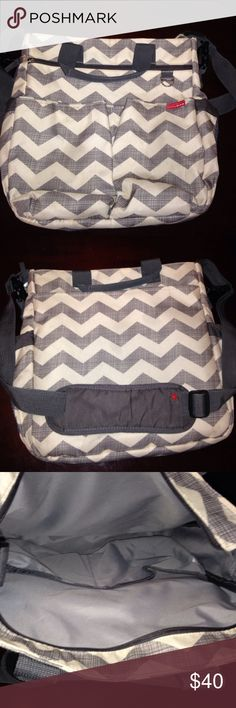 Skip*Hop Duo diaper bag Excellent used condition! Used for maybe a month but never remembered to bring it along! Comes with the diaper changing mat.   •Main compartment has zip closure •10 pockets •2 elasticized, mesh side pockets that fit most sized bottles •Front zip pocket and easy access tech pocket •Grab handles and adjustable shoulder strap with slip-on shoulder pad •Custom hardware with d-ring for toys or pacifier pocket •Contrasting lining for easy visibility •Patented shuttle clips…