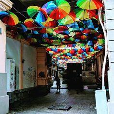 Umbrella alley in Bucharest is filled with restaurants cafes and bars Umbrella Street, Restaurant Ideas, Bucharest, Public Art, Umbrellas, Uni, Restaurants, Landscapes, Fair Grounds