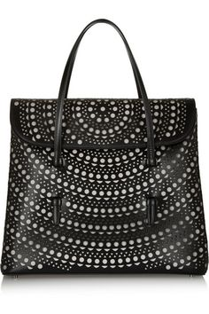 Shop now: Alaia........Loved the purse, but checked out the price tag: $3,950...what!? Where's the knockoff?