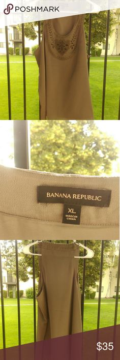 Banana Republic new Silk Yolk Tank Blouse This silk tank from Banana Republic is a very special piece and would be a great addition to any wardrobe. The shirt is lined, has embroidery all over the chest and around the collar. On trend Taupe color. Size XL never worn. Banana Republic Tops Blouses