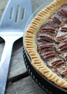 Classic pecan pie with crunchy, buttery pecans and a perfectly gooey filling that's even better with a scoop of vanilla ice cream.