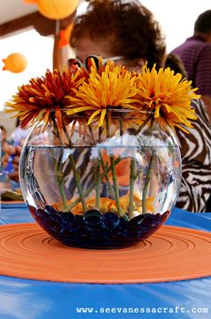 polka dot goldfish party: real live goldfish + blue glass gems for table centerpieces!  (Whoever wanted a fish bowl at the end of the party took home a new pet with baggies of fish food and care instructions).