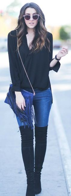 These over the knee boots look cute worn with a fringed scarf and simple V neck blouse. Via themiddlecloset.  Jeans: Frame Denim, Boots: Stuart Weitzman, Bag: Sole Society.