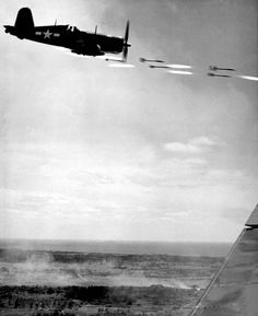 Corsair fighter looses its load of rocket projectiles on a run against a Jap…