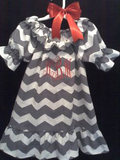 My mom made Kynzee a new dress!! I can't wait for her to wear it with her red leggings and silver boots.... This can be ordered.. Just send her an email at kndunder@aol.com you can find her on Facebook grand kid designs custom childrens clothing. Instagram grand_kid_designs and on Etsy!!