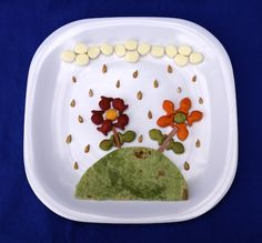 Rainy-Day Kids Snack: Cheese quesadilla garnished with Goldfish flowers and sunflower seed rain drops!