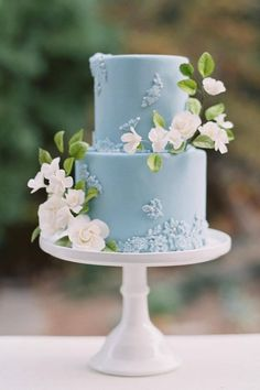 The prettiest shade of blue, sugar lace, and delicate creamy blooms. Can't stop staring, can't stop swooning. 😍 Photography: @lizzimbelmanphoto Planning: @atouchofgrace_events Cake: @flourandbloomcakes Florals: @bloomsbay Rentals: @brighteventrentals Venue: @montalvospecialevents #stylemepretty #weddingcake #bluecake #somethingblue #floralcake #flowercake