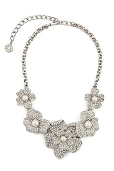 @Amber Delgado and @Amy Delgado what do you guys think of this necklace for the wedding. It kind of matches the hairpiece.