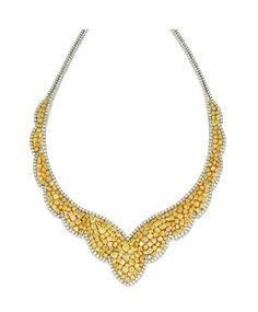 Lot 385 - 18 Karat White Gold, Diamond and Colored Diamond Necklace