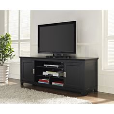 Enjoy your favorite movies and sports games with this wood media console. It's unique sliding wood doors make it easy to reach your media components and accessories with ample storage space.