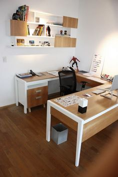 Love this wrap-around desk.  This is what I want, but not facing a wall like this one.