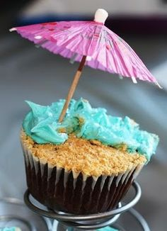 Beach themed cupcakes. Love the sand and water with the little umbrella on top.