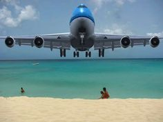 Sit on the beach by Princess Juliana International Airport in St. Maarten and watch the planes come in real low
