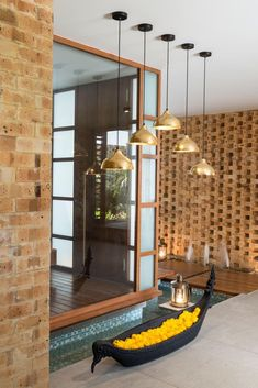 Image 16 of 32 from gallery of Tropical House Urveel / Design Work Group. Photograph by Photographix Pooja Room Door Design, Wall Design, Indian Room Decor, Temple Design For Home, India Home Decor, Dining Table Lighting, Puja Room, Bungalow House Design, Interior Decorating