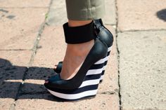 Striped black and white ankle wedge shoe.