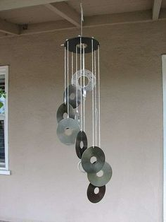 windchimes made from old CDs or hard drives.amazingly pretty when the sun is b. windchimes made from old CDs or hard drives…amazingly pretty when the sun is bouncing rainbows of Cd Diy, Carillons Diy, Recycled Cds, Recycled Crafts, Old Cd Crafts, Crafts With Cds, Cork Crafts, Make Wind Chimes, Homemade Wind Chimes
