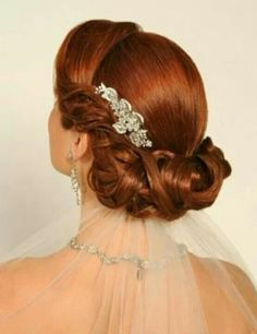 Bridal hair updo with veil under