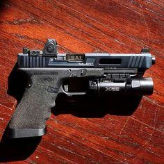 Salient Arms International Glock 34 Tier 1 w/Trijicon RMR + SureFire Ultra (there JUST HAS to be room for 1 more cut. Salient Arms, Custom Glock, Custom Guns, Weapons Guns, Guns And Ammo, Glock Mods, Cool Guns, Firearms, Shotguns