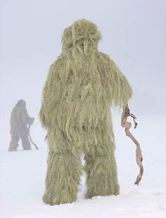 """Charles Fregér's 'Wilder Mann' project is a series of photographs of """"wild man"""" costumes used in traditional ceremonies and pageants. Shot in 18 European countries, the photographs depict men positioned by Fregér in costumes against sweeping winter landscapes."""