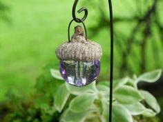 A cute little handmade acorn cap lantern to add some color and fun to your miniature garden, fairy garden, or terrarium. They look adorable