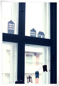 Paper cut outs of houses to sit in the window;  love them.  (Blog; My 2nd hand life)