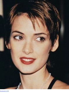 Winona Ryder wore her pixie long and loose with wispy bangs and elfin points at the sides and nape. Her variation of the cut is most suited to a slightly grungy aesthetic and is flattering on a variety of features.