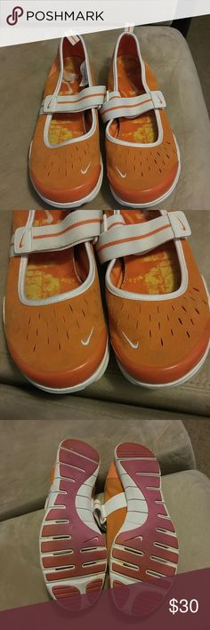 Orange and  white Nike walking sneakers Worn a few times  still in great condition great for walking and exercising  really cute.. Nike Shoes Athletic Shoes