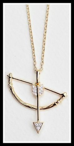India Hick Swinging Bow and Arrow Pendant. Via Diamonds in the Library's jewelry gift guide. .