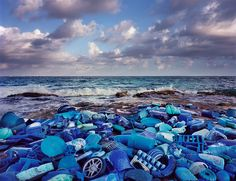 """Sian Ka'an is an extraordinary UNESCO tropical nature reserve along Mexico's Carribean coastline, but the currents that pass by this area bring garbage from all over the world to the shores of this paradise. Alejandro Duran, an artist working in Brooklyn, NY, collects this trash and arranges it into works of colorful landscape art to examine """"the tension between the natural world and an increasingly overdeveloped one."""""""