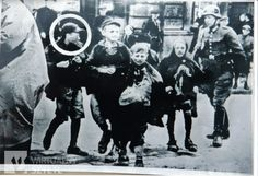 Zenek, 16 years old, caught with three children trying to smuggle a weapon into the Warsaw Ghetto.