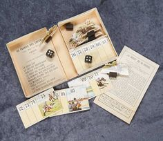 """French Boxed Miniature Game """"Le Jockey Jeu de Courses"""" from Au Paradis Des Enfants5"""" x 4"""" box. The heavy card stock box with image of jockey on horse, opens to reveal elaborately constructed luxury game with die-cut horses on wooden stands, and a number of playing cards and instructions. The label of Au Paradis des Enfants is on the inside lid, indicating the game was especially commissioned for the luxury Parisian toy store, circa 1880."""