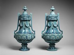 Ceramists Greber Charles (1853-1935) and Greber Pierre (1896-1965).  Those two urns were made in glazed ceramic between 1880 and 1899. The vibrant blue glaze emphasis the sobriety of the neo-classical style.
