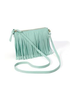 Festival season calls for fringe. Throw your must-haves in this head-turning cross-body bag when you're on the go, or remove the shoulder strap for a statement making clutch. (Plus the mint green shade adds a pop to any outfit.)