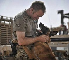 A soldier from 1 Mechanized Brigade and his military working dog in Helmand, Afghanistan. Photo courtesy of the British Army Facebook page.