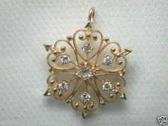Antique Art Deco Diamond Pin/Pendant D-.56 Carat Total Weight G - H VS 1  14K Yellow Solid Gold