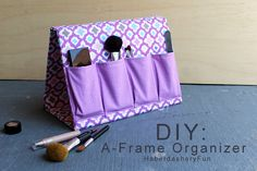"Sew a fabric binder that folds into an ""A"" shaped frame and has pockets. Perfect for storing everything!"