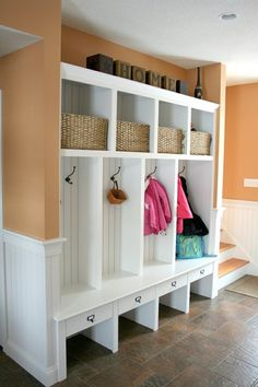 Entryway storage.  I'd like something like this in the addition.  Would it look weird if there were doors on the middle section of each locker?  Would the bench have to come out further?  I'd like the top and bottom to remain open like that. 5 Lockers instead of 4 (1 for guests).