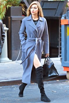 Leaving her Maybelline photo shoot in New York wearing a blue Iris Von Arnim trench coat and knee high boots.   - HarpersBAZAAR.com
