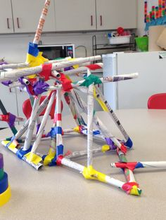 During a unit about recycling,we used newspapers rolled into 'sticks' and colored tape to create this sculpture.